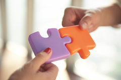 Business people group assembling jigsaw puzzle Stock Photo
