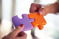 Business people group assembling jigsaw puzzle Stock Images