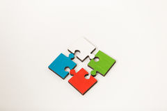 Business people group assembling jigsaw puzzle and represent team support Stock Images