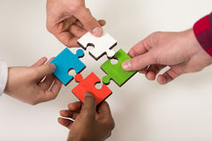 Business people group assembling jigsaw puzzle and represent team support Royalty Free Stock Photos