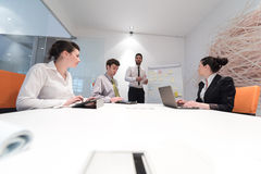 Business people group brainstorming and taking notes to flip boa Stock Images