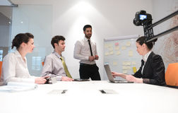 Business people group brainstorming and taking notes to flip boa Stock Photos