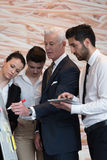 Business people group brainstorming and taking notes to flipboar Royalty Free Stock Images