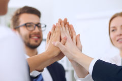 Business people group Business people group happy showing teamwork and joining hands or giving five after signing Royalty Free Stock Image