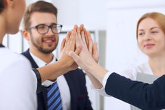 Business people group Business people group happy showing teamwork and joining hands or giving five after signing Royalty Free Stock Images
