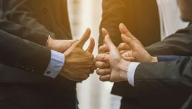 Business people group of hands making give thumbs up sign teamwork royalty free stock image