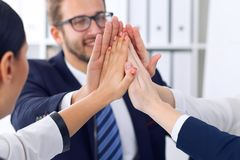 Business people group happy showing teamwork and joining hands or giving five after signing agreement or contract in. Office, close-up royalty free stock photo