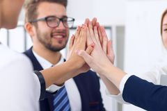 Business people group happy showing teamwork and joining hands or giving five after signing agreement or contract in Royalty Free Stock Photos