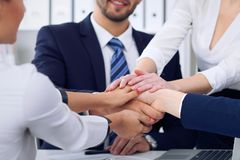 Business people group happy showing teamwork and joining hands or giving five after signing agreement or contract in Stock Photo