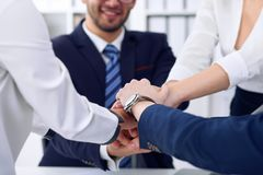 Business people group happy showing teamwork and joining hands or giving five after signing agreement or contract in Royalty Free Stock Image