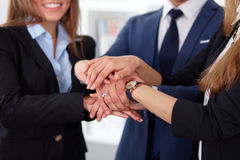 Business people group joining hands and representing concept of friendship and teamwork Royalty Free Stock Photos