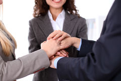 Business people group joining hands and representing concept of friendship and teamwork Royalty Free Stock Images