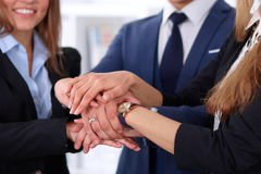 Business people group joining hands and representing concept of friendship and teamwork Royalty Free Stock Photo