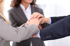 Business people group joining hands and representing concept of friendship and teamwork Stock Images