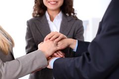 Business people group joining hands and representing concept of friendship and teamwork Royalty Free Stock Image