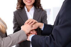 Business people group joining hands and representing concept of friendship and teamwork Stock Image
