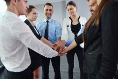 Business people group joining hands Royalty Free Stock Image