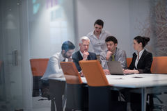 Business people group on meeting at modern startup office. Young business people group on meeting at modern startup office with senior manager. Team leader royalty free stock photography