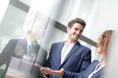 Business people group meeting. Pointing something in front of the office window, asian people,european Stock Image