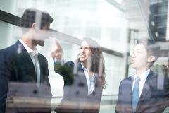 Business people group meeting. Pointing something in front of the office window, asian people,european Royalty Free Stock Photo