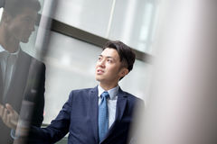 Business people group meeting. Pointing something in front of the office window, asian people,european Royalty Free Stock Photos