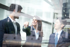 Business people group meeting. Pointing something in front of the office window, asian people,european Stock Photos