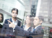 Business people group meeting. Pointing something in front of the office window, asian people,european Stock Photo