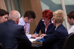 Business people group sign contract Stock Images