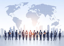 Business People Group Silhouettes Over City Landscape World Map Stock Photo