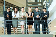 Business people. Group of business people standing by stairway Royalty Free Stock Photography