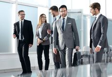 Group of young associates going to business meeting. stock image