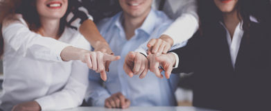 Business people group team point finger at you. In office Stock Photos