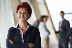 Business people group, woman in front  as team leader Stock Photos