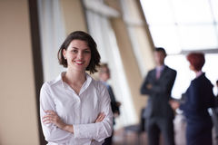 Business people group, woman in front  as team leader Stock Images