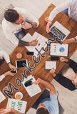 Business people group work at marketing in office, top view. Marketing meeting. Group of business people work in office, top view of wood table with mobile Royalty Free Stock Photos
