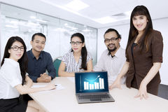 Business people with growth chart on the laptop Stock Photos