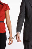 Business people handcuffed together Stock Photography