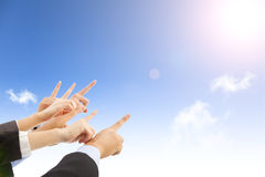 Business people hands with blue sky background Stock Photo
