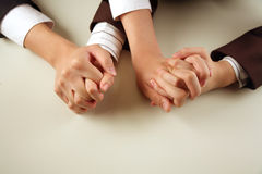 Business people with hands intertwined Stock Image