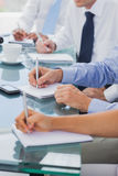 Business people hands taking notes Royalty Free Stock Image