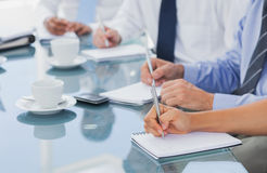 Business people hands taking some notes Royalty Free Stock Photos