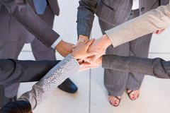 Business people with hands together Stock Photos