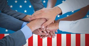 Business people with hands together against american flag Royalty Free Stock Photos