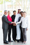 Business people hands together. United business people putting their hands together Stock Photo