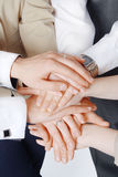 Business people hands on top of each other Stock Image