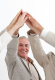 Business people with hands up showing positivety Stock Images