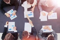 Business people handshake. Businessmen hand shake, during meeting signing agreement sitting at desk team work group on conference discussing financial diagram Stock Images