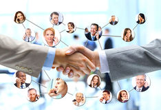 Business people handshake with company team. In background Royalty Free Stock Photo