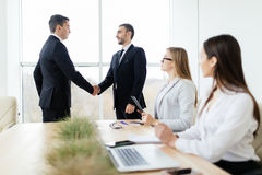 Business people handshake get agree sign of contract in meeting room. Corporate work. Business people handshake get agree sign of contract in meeting room Royalty Free Stock Photo