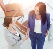 Business people handshake in modern office. Greeting deal concep stock photo
